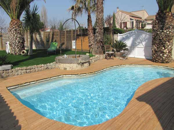D coration terrasse piscine bois exemples d 39 am nagements Deco abord piscine